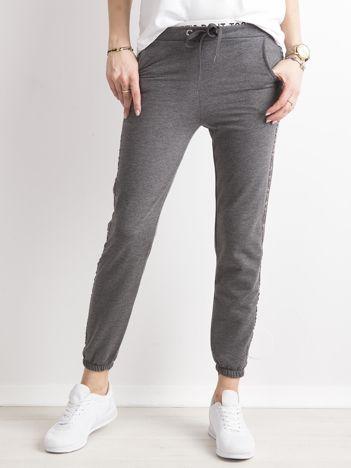 Ciemnoszare damskie spodnie dresowe z lampasami