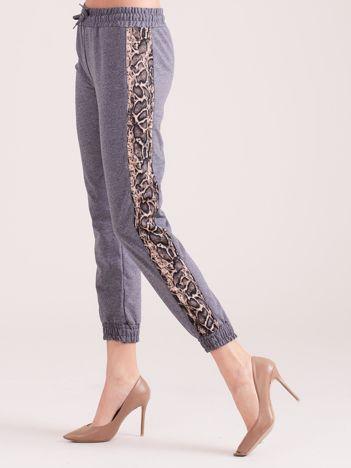 Ciemnoszare spodnie dresowe z panterkowym lampasem