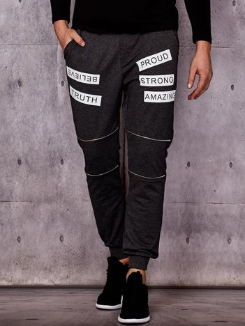 Ciemnoszare spodnie dresowe z suwakami i napisami