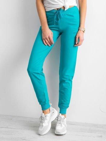 Ciemnozielone spodnie dresowe z troczkami