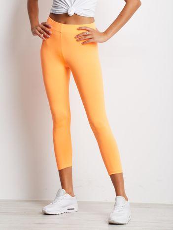 Cienkie legginsy sportowe o długości 3/4 fluo pomarańczowe