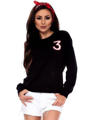 Czarna bluza z błyszczącą cyfrą