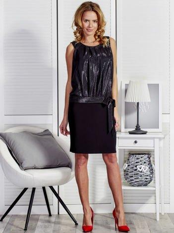 Czarna sukienka wieczorowa z błyszczącą górą