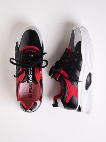Czarne buty sportowe ze skórzanymi czerwonymi wstawkami