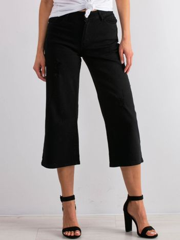 Czarne jeansy Reasons