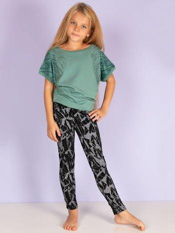 Czarne legginsy dla dziewczynki we wzory