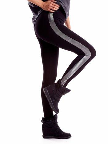 Czarne legginsy z błyszczącymi lampasami