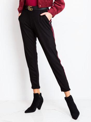 Czarne spodnie Truth