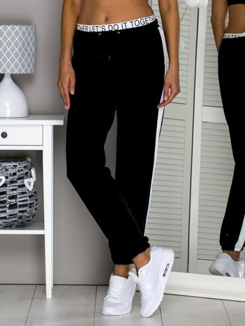 Czarne spodnie dresowe LET'S DO IT TOGETHER