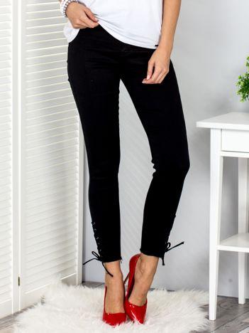 Czarne spodnie slim ze sznurowanymi nogawkami