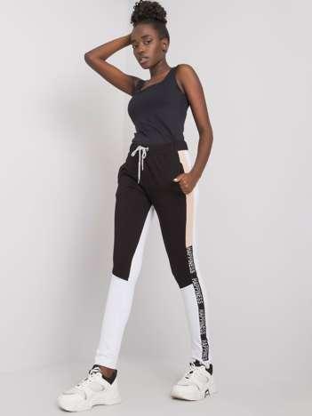 Czarno-białe spodnie dresowe z lampasami Happy