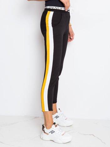 Czarno-żółte spodnie Hidden