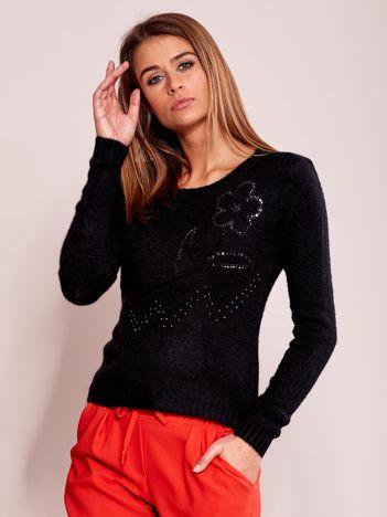 Czarny sweter damski z cekinami