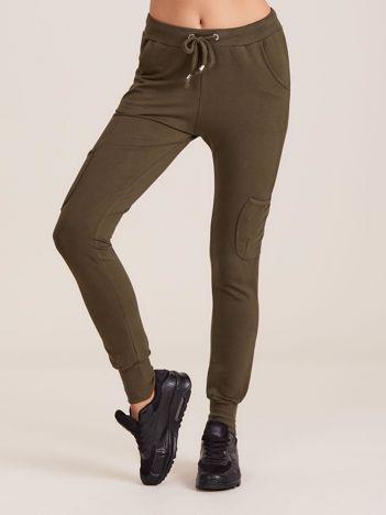 Damskie spodnie dresowe ze ściągaczami khaki