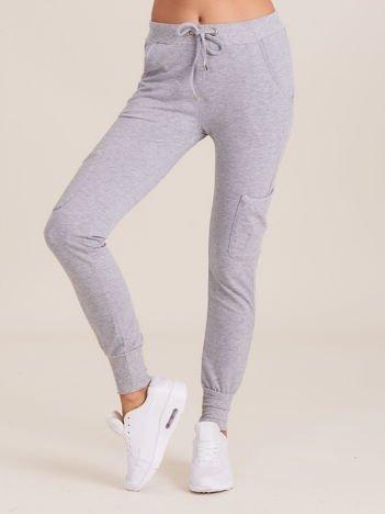 Damskie spodnie dresowe ze ściągaczami szare
