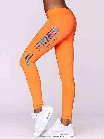 Długie legginsy do ćwiczeń z kolorowym nadrukiem fluo pomarańczowe