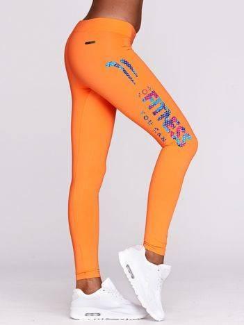Długie legginsy fitness z nadrukiem i logo fluo pomarańczowe