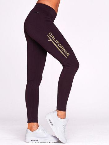 Długie legginsy na siłownię z motywem CALIFORNIA ciemnofioletowe