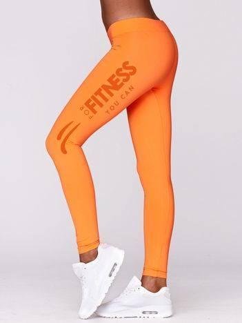 Długie legginsy na siłownię ze sportowym nadrukiem fluo pomarańczowe