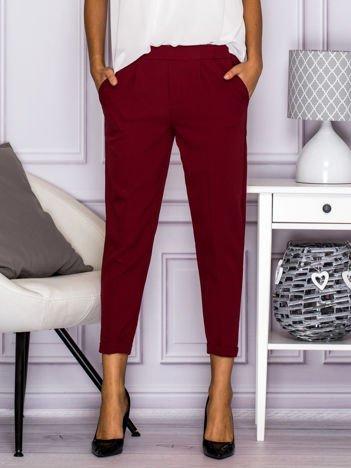 Eleganckie spodnie cygaretki w kant bordowe