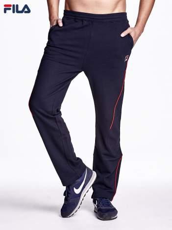 FILA Granatowe spodnie dresowe męskie z modelującymi przeszyciami