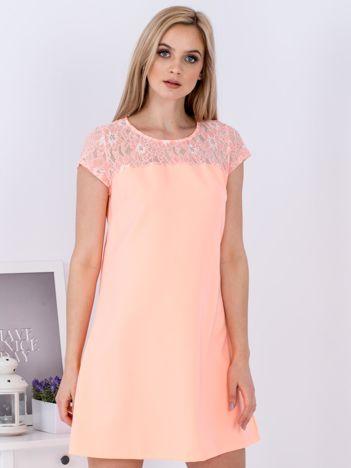 Fluo pomarańczowa trapezowa sukienka z koronkową górą