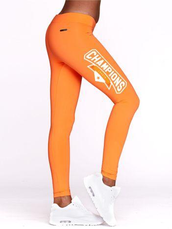 Fluo pomarańczowe legginsy na siłownię z nadrukiem CHAMPIONS
