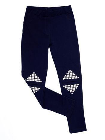 Granatowe legginsy dla dziewczynki z rozcięciami i aplikacją