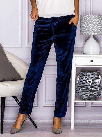 Granatowe welurowe spodnie z troczkami