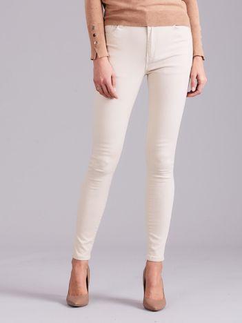 Jasnobeżowe spodnie jeansowe
