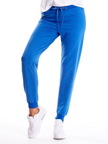 Jasnokobaltowe spodnie dresowe z troczkami