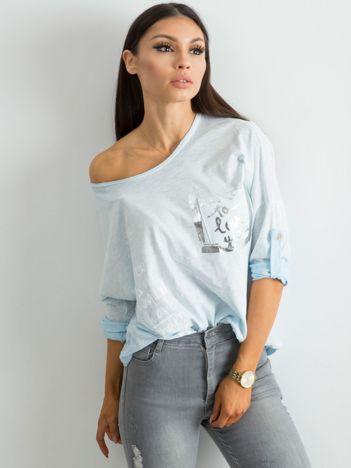 Jasnoniebieska luźna bluzka damska