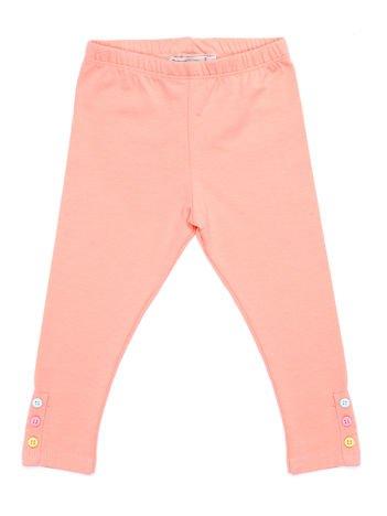 Jasnopomarańczowe legginsy dla dziewczynki z kolorowymi guzikami