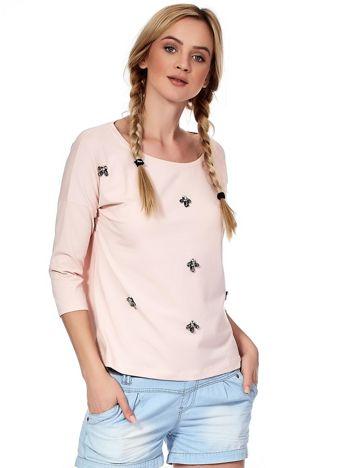 Jasnoróżowa bluzka z diamencikami