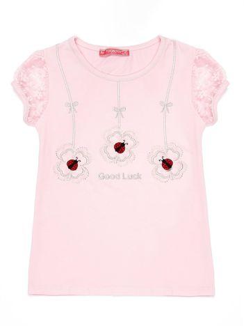 Jasnoróżowy t-shirt dla dziewczynki z biedronkami