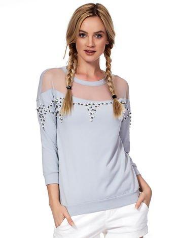 Jasnoszara bluza z transparentnym dekoltem i perełkami