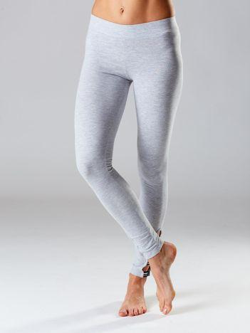 Jasnoszare legginsy z wycięciami na nogawkach