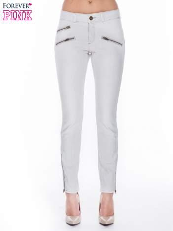 Jasnoszare spodnie jeansowe typu skinny z suwakami