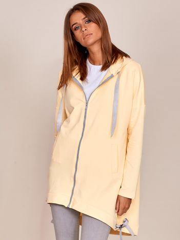 Jasnożółta długa bluza na suwak z kapturem i wstążkami