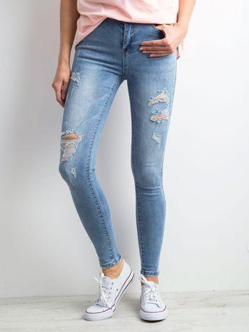 Jeansowe rurki z przetarciami niebieskie