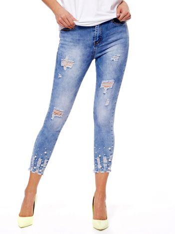 Jeansy niebieskie z perełkami i przetarciami