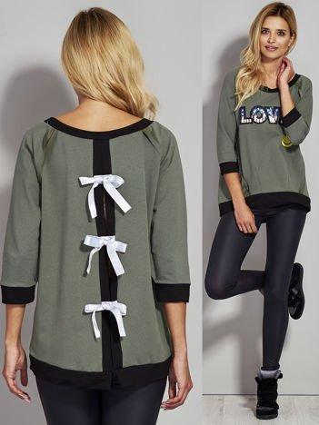 Khaki bluza z cekinowym napisem LOVE i kokardami z tyłu