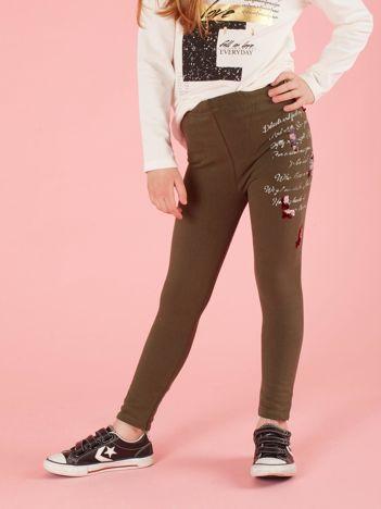 Khaki legginsy dla dziewczynki z aplikacją