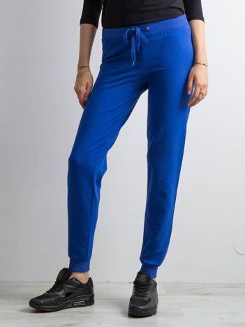 Kobaltowe spodnie dresowe z troczkami