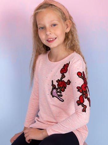 Koralowa bluzka dziewczęca z kwiatowymi naszywkami
