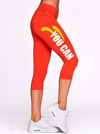 Krótkie legginsy do biegania ze sportowym napisem ciemnopomarańczowe