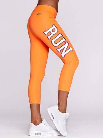 Legginsy do biegania z napisem RUN fluo pomarańczowe