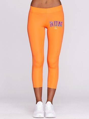 Legginsy do biegania z napisem RUN z przodu fluo pomarańczowe