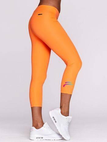 Legginsy do biegania ze sportowym symbolem fluopomarańczowe
