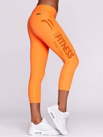Legginsy do fitnessu z napisem na nogawce fluo pomarańczowe